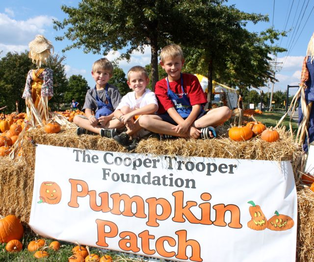 Boys with Pumpkin Patch sign